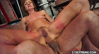 Grandma rails on a thick young cock.